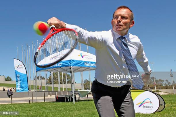 Leader of the Opposition Tony Abbott plays tennis outside Parliament House as part of the Australian Open Trophy Tour on November 18 2010 in Canberra...