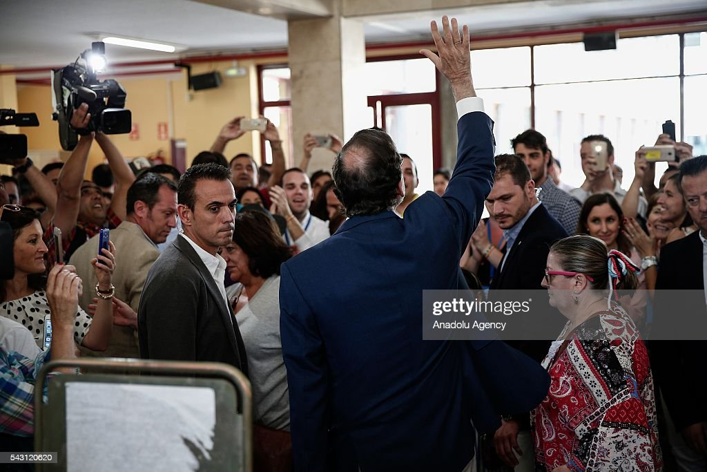 Leader of the People's Party and Spanish Prime Minister Mariano Rajoy greets the voters after casting his ballot at a polling station during the Spanish general election in Madrid, Spain on June 26, 2016.