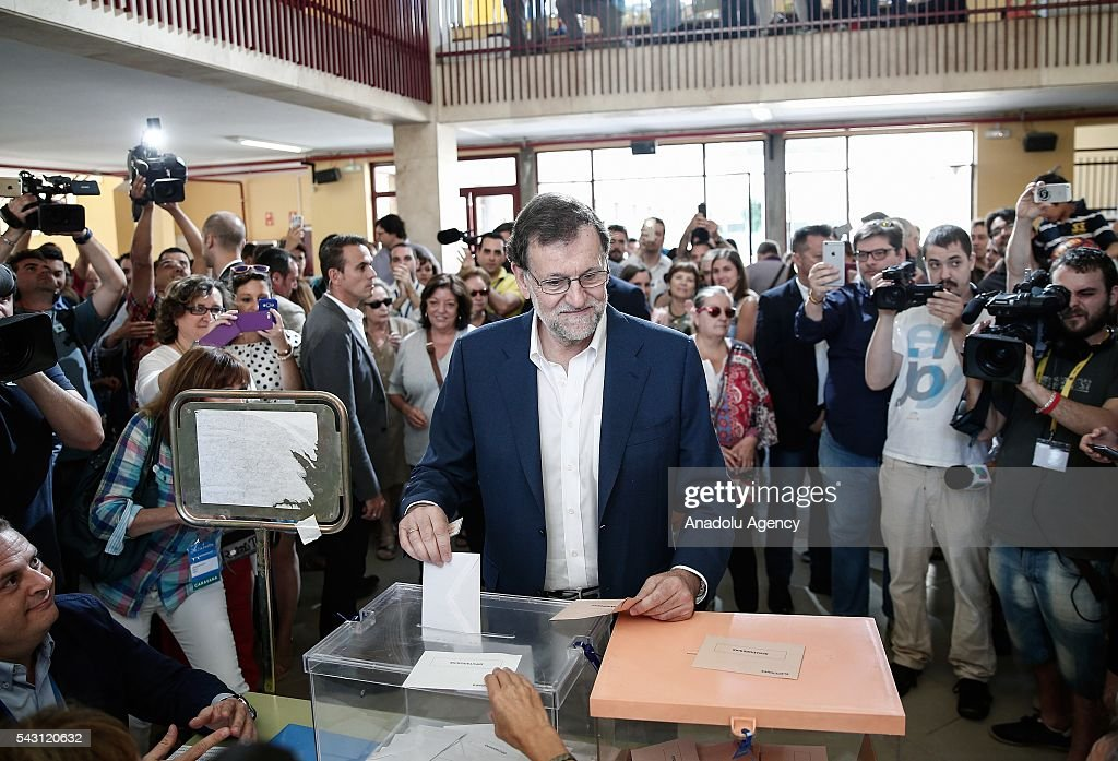 Leader of the People's Party and Spanish Prime Minister Mariano Rajoy casts his ballot at a polling station during the Spanish general election in Madrid, Spain on June 26, 2016.