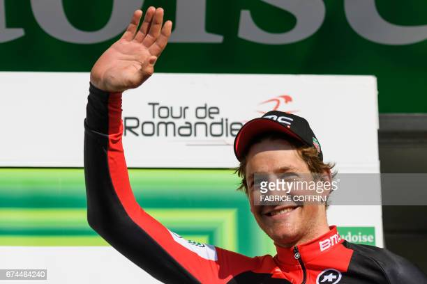 Leader of the point classment Swiss Stefan Kueng of team BMC waves during the podium ceremony of the third stage of Tour de Romandie UCI protour...