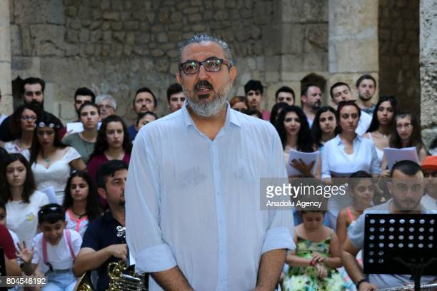 Leader of the Polyphonic Choruses Association of Antakya Sezgin Suna delivers a speech during the Feast of Saints Peter and Paul at Batiayaz Armenian...