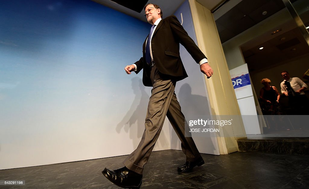 Leader of the Popular Party (PP) and Spain's caretaker Prime Minister, Mariano Rajoy arrives for a press conference after a meeting of the national executive committee held one day after the Spanish general elections, at the PP headquarters in Madrid, on June 27, 2016. Spain hoped on June 27 that repeat weekend elections would unblock the country's political paralysis after the conservatives came out strengthened with more seats, although they still face resistance from hostile rivals. / AFP / JOSE