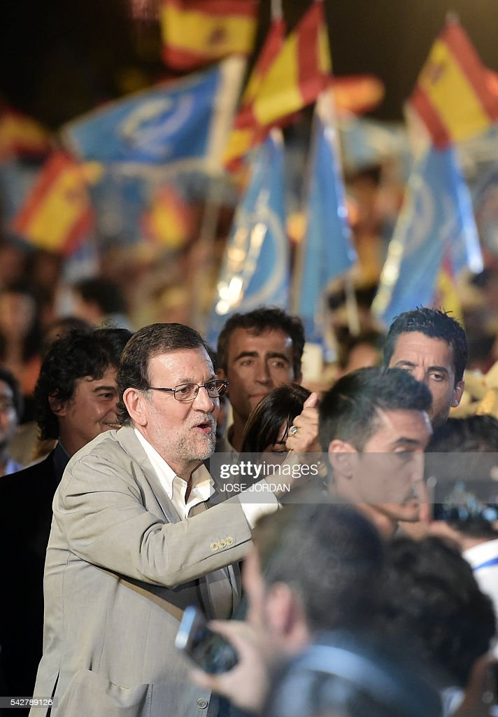 Leader of the Popular Party (PP) and Spain's caretaker Prime Minister and party candidate, Mariano Rajoy walks through the crowd on arrival to the partys final campaign meeting in Madrid on June 24, 2016 ahead of the June 26 general election. Spain votes again on June 26, six months after an inconclusive election which saw parties unable to agree on a coalition government. JORDAN