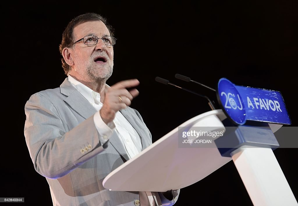 Leader of the Popular Party (PP) and Spain's caretaker Prime Minister and party candidate, Mariano Rajoy speaks during the partys final campaign meeting in Madrid on June 24, 2016 ahead of the June 26 general election. Spain votes again on June 26, six months after an inconclusive election which saw parties unable to agree on a coalition government. JORDAN