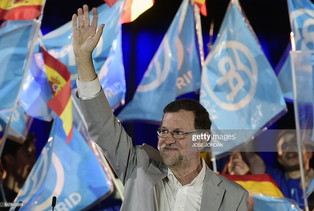 Leader of the Popular Party (PP) and Spain's caretaker Prime Minister and party candidate, Mariano Rajoy waves after the partys final campaign meeting in Madrid on June 24, 2016 ahead of the June 26 general election. Spain votes again on June 26, six months after an inconclusive election which saw parties unable to agree on a coalition government. JORDAN