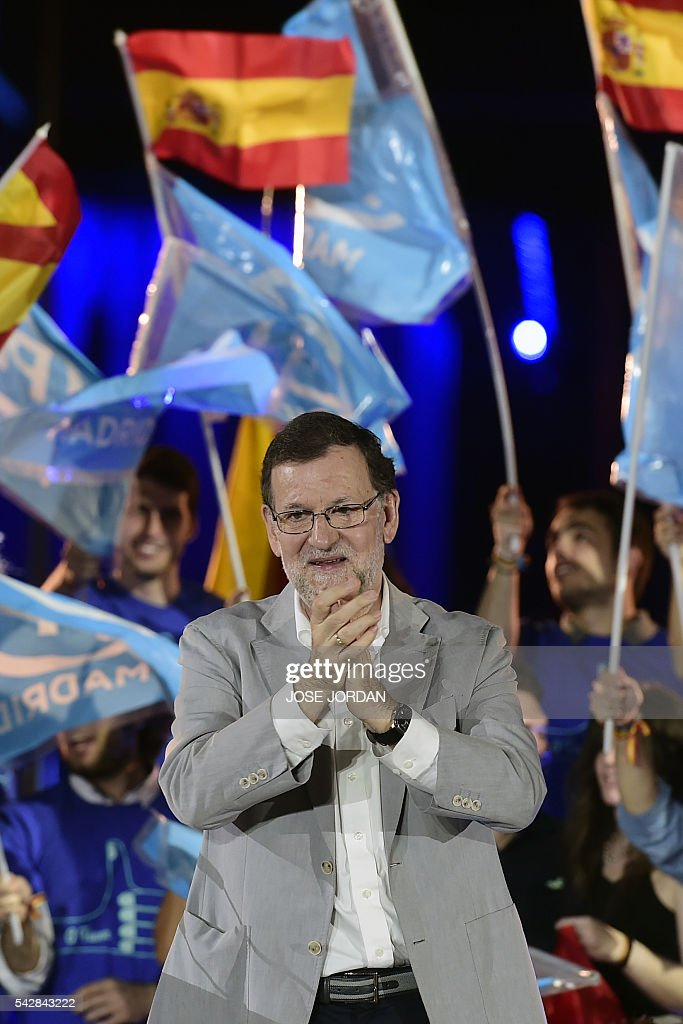 Leader of the Popular Party (PP) and Spain's caretaker Prime Minister and party candidate, Mariano Rajoy claps after the partys final campaign meeting in Madrid on June 24, 2016 ahead of the June 26 general election. Spain votes again on June 26, six months after an inconclusive election which saw parties unable to agree on a coalition government. JORDAN