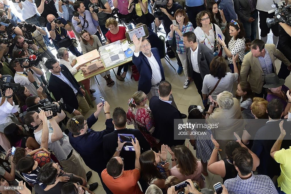 Leader of the Popular Party (PP) and Spain's caretaker Prime Minister and party candidate, Mariano Rajoy, waves after voting in Spains general election at the Bernadette college polling station in Moncloa-Aravaca, Madrid, on June 26, 2016. Spain votes today, six months after an inconclusive election which saw parties unable to agree on a coalition government. JORDAN