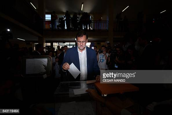 Leader of the Popular Party and Spain's caretaker Prime Minister and party candidate Mariano Rajoy casts his vote in Spains general election at the...