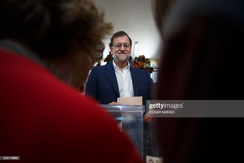 Leader of the Popular Party (PP) and Spain's caretaker Prime Minister and party candidate, Mariano Rajoy, arrives to vote in Spains general election at the Bernadette college polling station in Moncloa-Aravaca, Madrid, on June 26, 2016. Spain votes today, six months after an inconclusive election which saw parties unable to agree on a coalition government. MANSO