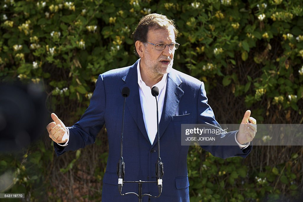 Leader of the Popular Party (PP) and Spain's caretaker Prime Minister and party candidate, Mariano Rajoy, speaks to the press before casting his vote in Spains general election at the Bernadette college polling station in Moncloa-Aravaca, Madrid, on June 26, 2016. Spain votes today, six months after an inconclusive election which saw parties unable to agree on a coalition government. JORDAN
