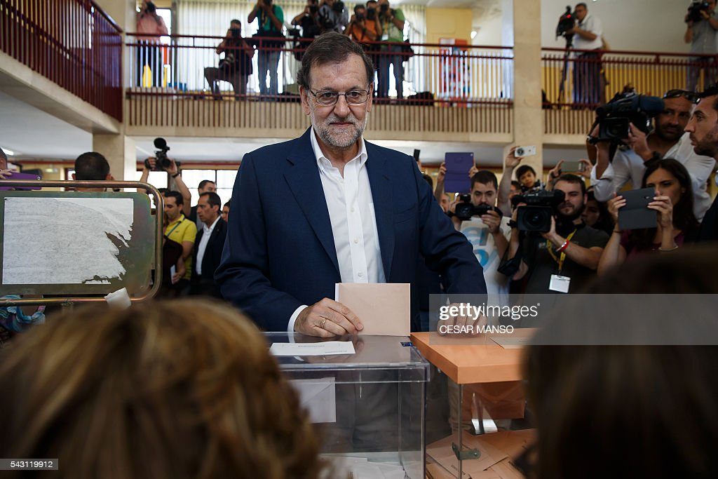 Leader of the Popular Party (PP) and Spain's caretaker Prime Minister and party candidate, Mariano Rajoy, prepares to vote in Spains general election at the Bernadette college polling station in Moncloa-Aravaca, Madrid, on June 26, 2016. Spain votes today, six months after an inconclusive election which saw parties unable to agree on a coalition government. MANSO