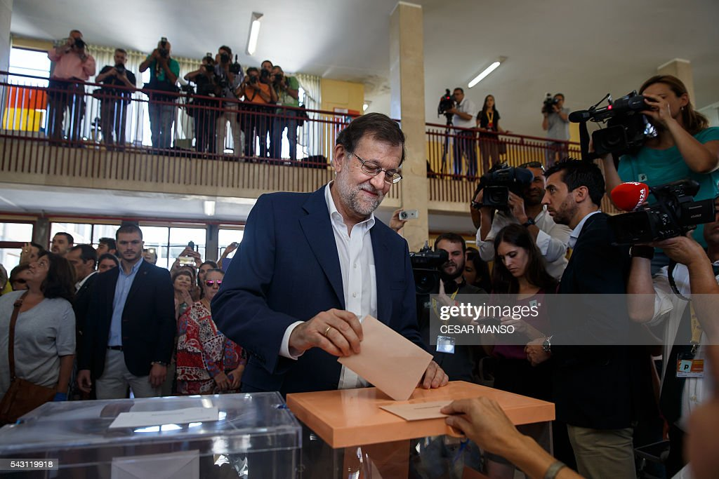 Leader of the Popular Party (PP) and Spain's caretaker Prime Minister and party candidate, Mariano Rajoy, casts his vote in Spains general election at the Bernadette college polling station in Moncloa-Aravaca, Madrid, on June 26, 2016. Spain votes today, six months after an inconclusive election which saw parties unable to agree on a coalition government. MANSO