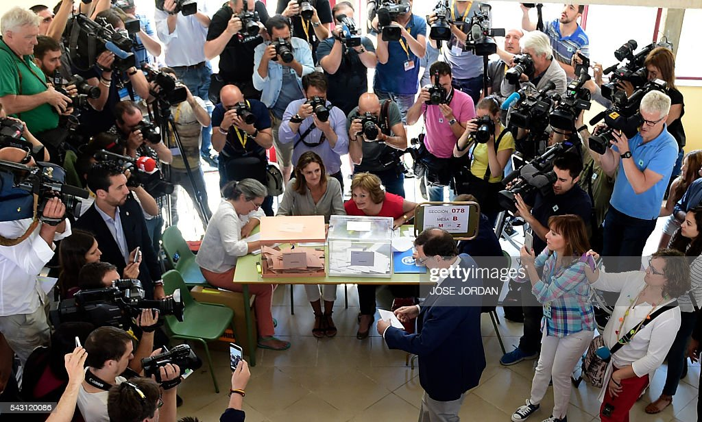 Leader of the Popular Party (PP) and Spain's caretaker Prime Minister and party candidate, Mariano Rajoy, arrives to vote in Spains general election at the Bernadette college polling station in Moncloa-Aravaca, Madrid, on June 26, 2016. Spain votes today, six months after an inconclusive election which saw parties unable to agree on a coalition government. JORDAN