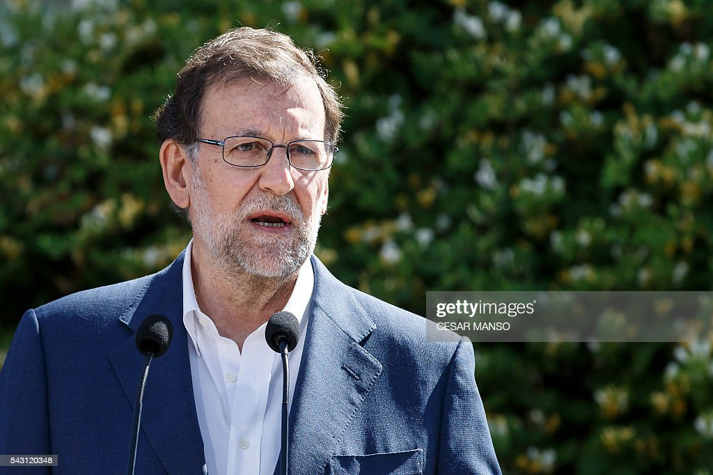 Leader of the Popular Party (PP) and Spain's caretaker Prime Minister and party candidate, Mariano Rajoy, speaks to the press after voting in Spains general election at the Bernadette college polling station in Moncloa-Aravaca, Madrid, on June 26, 2016. Spain votes today, six months after an inconclusive election which saw parties unable to agree on a coalition government. MANSO