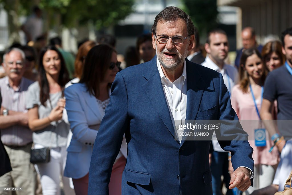 Leader of the Popular Party (PP) and Spain's caretaker Prime Minister and party candidate, Mariano Rajoy, walks before casting his vote in Spains general election at the Bernadette college polling station in Moncloa-Aravaca, Madrid, on June 26, 2016. Spain votes today, six months after an inconclusive election which saw parties unable to agree on a coalition government. MANSO