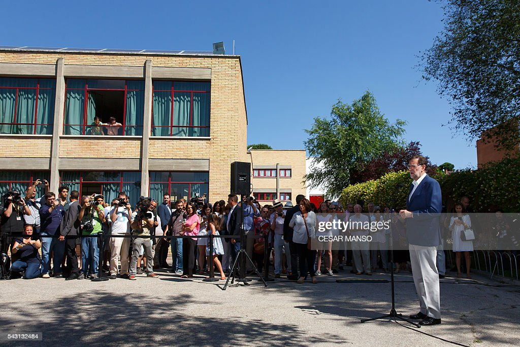 Leader of the Popular Party (PP) and Spain's caretaker Prime Minister and party candidate, Mariano Rajoy, speaks to the press before voting in Spains general election at the Bernadette college polling station in Moncloa-Aravaca, Madrid, on June 26, 2016. Spain votes today, six months after an inconclusive election which saw parties unable to agree on a coalition government. MANSO