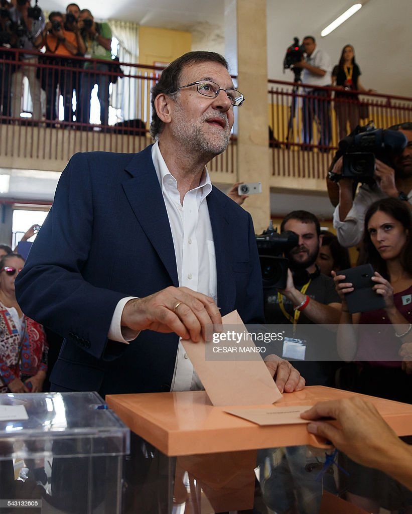 Leader of the Popular Party (PP) and Spain's caretaker Prime Minister and party candidate, Mariano Rajoy, votes in Spains general election at the Bernadette college polling station in Moncloa-Aravaca, Madrid, on June 26, 2016. Spain votes today, six months after an inconclusive election which saw parties unable to agree on a coalition government. MANSO