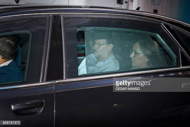 Leader of the Popular Party Spain's caretaker Prime Minister and party candidate Mariano Rajoy arrives in a car at the PP headquarters during Spain's...