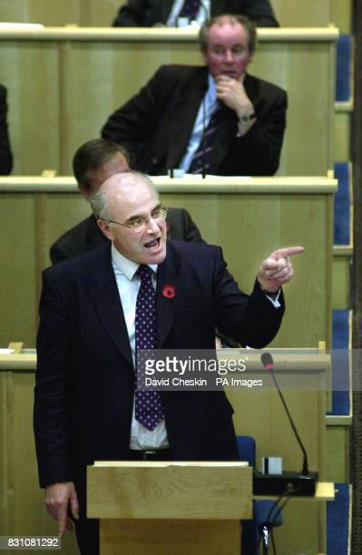 Leader of the Scottish Conservative party David McLetchie points the finger at Henry McLeish during First Minister's Question Time in the Scottish...