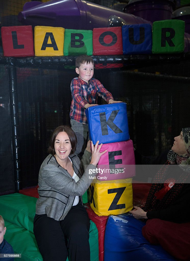 Leader of the Scottish Labour Party Kezia Dugdale and four-year-old Isaac Oliver pose for a photograph as she visits a soft play on May 3, 2016 in Glasgow, Scotland. As campaigning for the Holyrood election enters its last forty eight hours, recent polls suggest the Conservatives are virtually neck-and-neck with Labour in the race to be the main opposition party in Scotland.