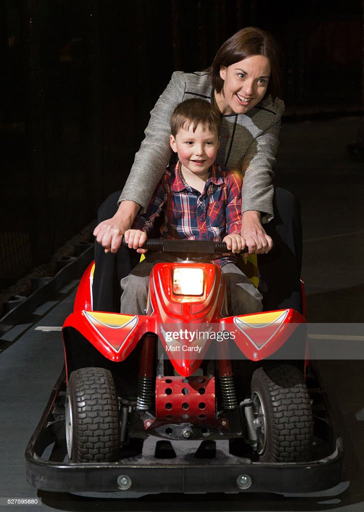 Leader of the Scottish Labour Party Kezia Dugdale and four-year-old Isaac Oliver ride on a go-kart as she visits a soft play on May 3, 2016 in Glasgow, Scotland. As campaigning for the Holyrood election enters its last forty eight hours, recent polls suggest the Conservatives are virtually neck-and-neck with Labour in the race to be the main opposition party in Scotland.