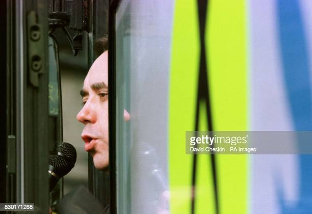 Leader of the Scottish National Party Alex Salmond looks out from the door of his campaign bus The SNP rally at Calton Hill in Edinburgh was his...