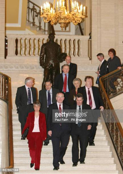 Leader of the SDLP Mark Durkan with party colleagues on their way into the first sitting of the newly elected Northern Ireland Assembly at Stormont