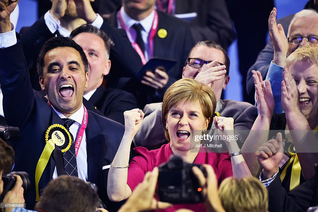 Leader of the SNP <a gi-track='captionPersonalityLinkClicked' href=/galleries/search?phrase=Nicola+Sturgeon&family=editorial&specificpeople=2582617 ng-click='$event.stopPropagation()'>Nicola Sturgeon</a> celebrates during the Glasgow declarations on May 8, 2015 in Glasgow, Scotland. The United Kingdom has gone to the polls to vote for a new government in one of the most closely fought General Elections in recent history. With the result too close to call it is anticipated that there will be no overall clear majority winner and a coalition government will have to be formed once again.