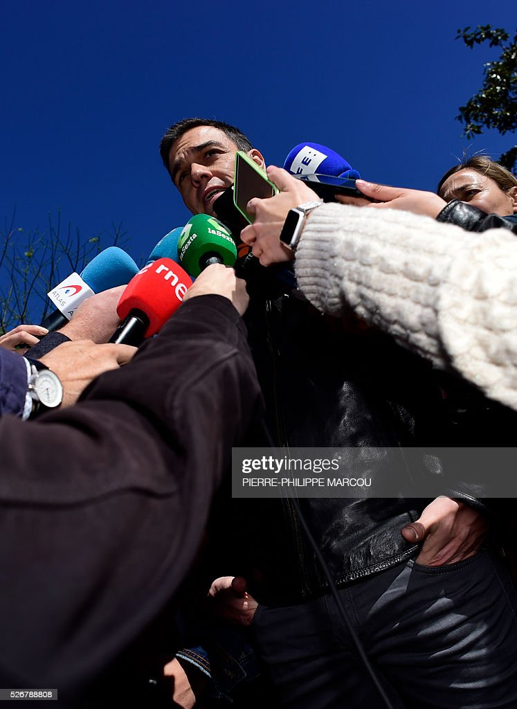 Leader of the Socialist Party (PSOE) Pedro Sanchez speaks to media before the traditional May Day rally in Madrid on May 1, 2016. / AFP / PIERRE