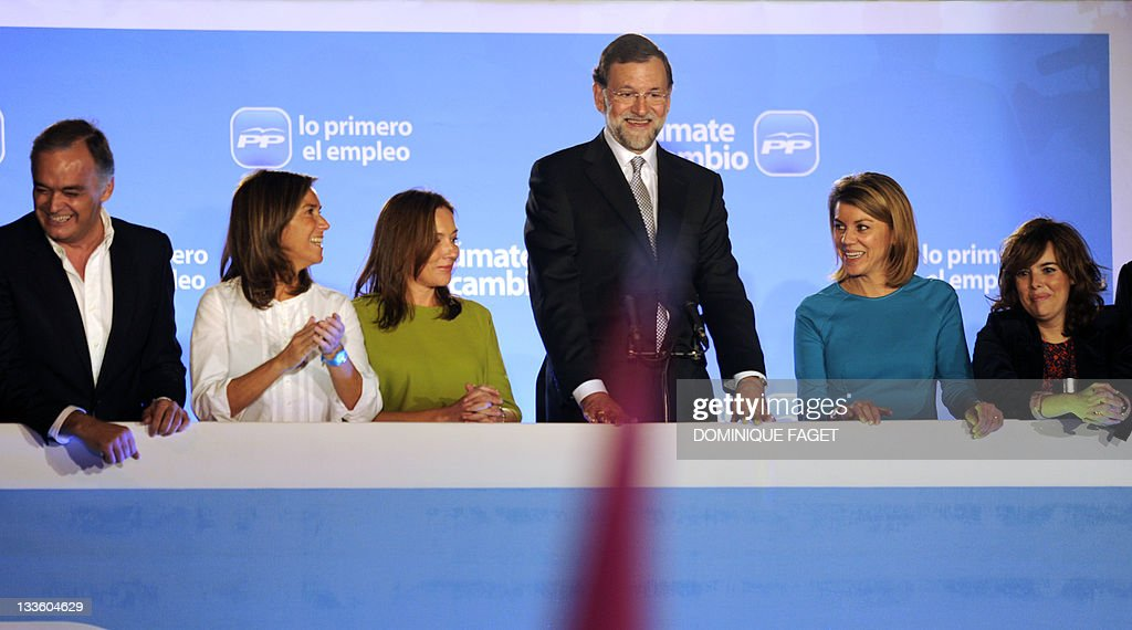 Leader of the Spanish Popular Party Mariano Rajoy jumps in celebration next to PP deputy Comunication secretary Esteban Gonzalez Pons PP deputy...