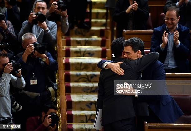Leader of the Spanish Socialist Party and candidate for prime minister Pedro Sanchez hugs PSOE's spokesperson in the Spanish Congress of Deputies...