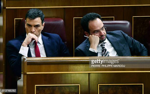 Leader of the Spanish Socialst Party and candidate for Prime Minister Pedro Sanchez sits next to Socialist spokesman Antonio Hernando at Las Cortes...