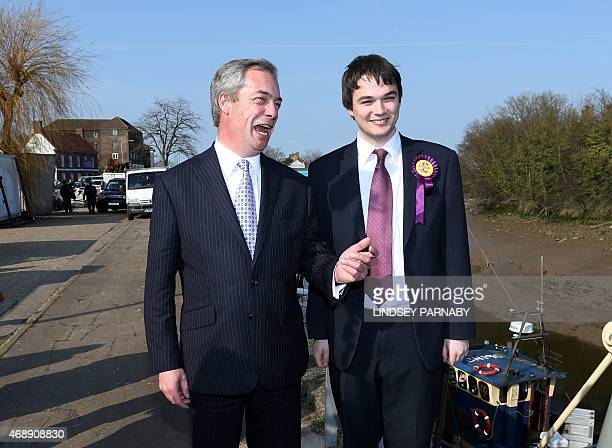 Leader of the UK Independence Party Nigel Farage attends a photocall with local UKIP candidate Robin HunterClarke after speaking to local fishermen...