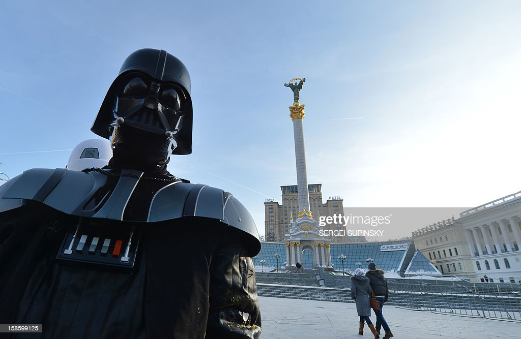 A leader of the Ukrainian Internet Party, wearing a Darth Vader outfit from the Star Wars saga, stands on December 20, 2012 on Independence Square in Kiev during a happening. The party activists, who traditionally wear Star Wars costumes during their actions, distributed canned foods, matches, condoms, toilet paper, soap, lightbulbs and 'tickets' for their spacecraft evacuation to passersby to supposedly save Ukrainians from the end of the world on December 21. The date marks the end of an era that lasted over 5,000 years, according to the Mayan 'Long Count' calendar. Some believe that the date, which coincides with the December solstice, marks the end of the world as foretold by Mayan hieroglyphs -- an idea ridiculed by scholars. AFP PHOTO/ SERGEI SUPINSKY