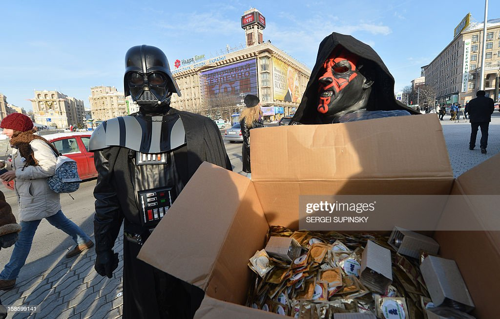 A leader of the Ukrainian Internet Party, wearing a Darth Vader outfit from the Star Wars saga, and an activist distribute goods on December 20, 2012 on Independence Square in Kiev. The party activists, who traditionally wear Star Wars costumes during their actions, distributed canned foods, matches, condoms, toilet paper, soap, lightbulbs and 'tickets' for their spacecraft evacuation to passersby to supposedly save Ukrainians from the end of the world on December 21. The date marks the end of an era that lasted over 5,000 years, according to the Mayan 'Long Count' calendar. Some believe that the date, which coincides with the December solstice, marks the end of the world as foretold by Mayan hieroglyphs -- an idea ridiculed by scholars.