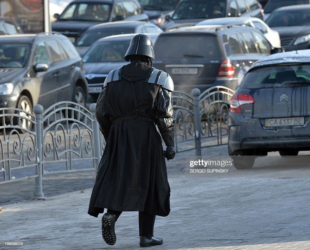 A leader of the Ukrainian Internet Party, wearing a Darth Vader outfit from the Star Wars saga, leaves Independence Square in Kiev on December 20, 2012 after a happening. Party activists, who traditionally wear Star Wars costumes during their actions, distributed canned foods, matches, condoms, toilet paper, soap, lightbulbs and 'tickets' for their spacecraft evacuation to passersby to supposedly save Ukrainians from the end of the world on December 21. The date marks the end of an era that lasted over 5,000 years, according to the Mayan 'Long Count' calendar. Some believe that the date, which coincides with the December solstice, marks the end of the world as foretold by Mayan hieroglyphs -- an idea ridiculed by scholars.