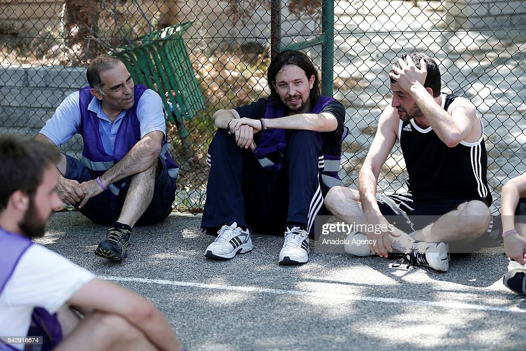 Leader of the Unidos Podemos 'United We Can', Pablo Iglesias (R) has a break as he plays basketball with his friends ahead of Spanish General Elections in Madrid, Spain on June 25, 2016.