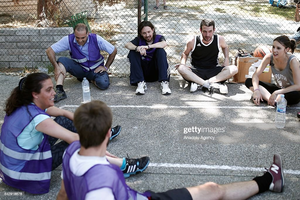Leader of the Unidos Podemos 'United We Can', Pablo Iglesias (3rd R) has a break as he plays basketball with his friends ahead of Spanish General Elections in Madrid, Spain on June 25, 2016.