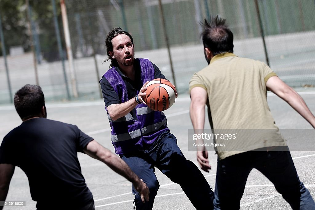Leader of the Unidos Podemos 'United We Can', Pablo Iglesias (C) plays basketball with his friends ahead of Spanish General Elections in Madrid, Spain on June 25, 2016.