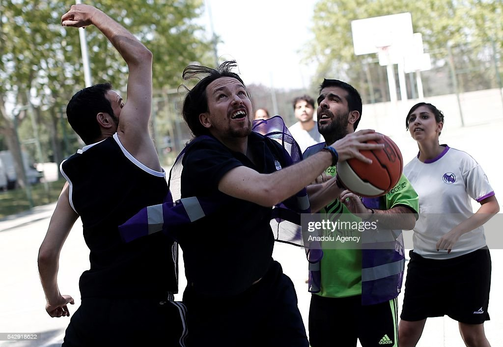 Leader of the Unidos Podemos 'United We Can', Pablo Iglesias (2nd L) plays basketball with his friends ahead of Spanish General Elections in Madrid, Spain on June 25, 2016.
