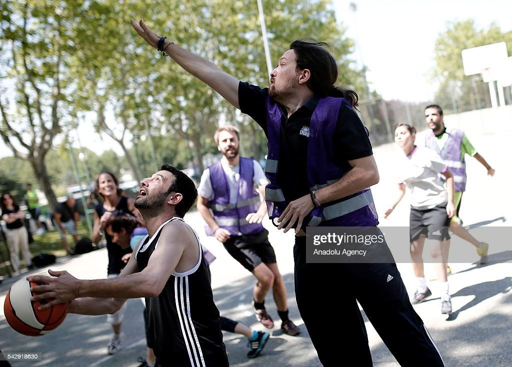 Leader of the Unidos Podemos 'United We Can', Pablo Iglesias (R) plays basketball with his friends ahead of Spanish General Elections in Madrid, Spain on June 25, 2016.