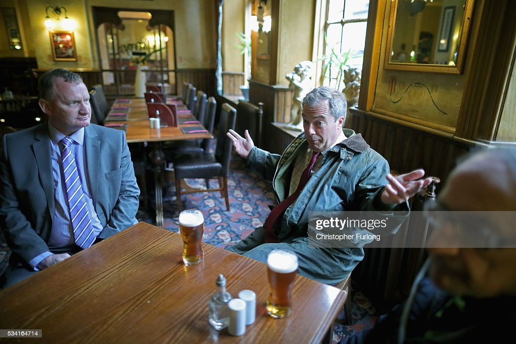 Leader of the United Kingdom Independence Party (UKIP), Nigel Farage enjoys a pint of beer during a break from campaigning for votes to leave the European Union on May 25, 2016 in Bolton, England. Nigel Farage took his battle bus to Bolton encouraging British people to vote to leave the EU on 23rd June 2016.