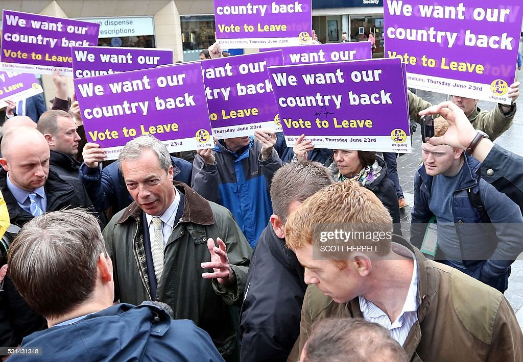 Leader of the United Kingdom Independence Party (UKIP), Nigel Farage (Centre L) canvasses for supporters whilst campaigning to leave the European Union, ahead of the June 23 referendum, in Newcastle upon Tyne, north-east England on May 26, 2016. A series of recent polls suggest a widening lead for supporters of Britain's continued European Union membership, handing 'Remain' campaigners a psychological boost, before the country votes in a crucial in-out referendum on June 23. / AFP / SCOTT