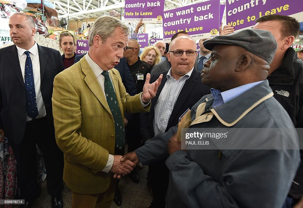 Leader of the United Kingdom Independence Party (UKIP) Nigel Farage (2L) gestures as he campaigns to leave the European Union during a stop on his anti-EU bus tour, in Birmingham, central England, on May 31, 2016, ahead of Britain's forthcoming EU referendum. Politicians and world leaders have dominated the headlines in the campaign for Britain's Jun 23, 2016 EU referendum, but a passionate battle for the country's future is also being fought by activists on the streets. / AFP / PAUL