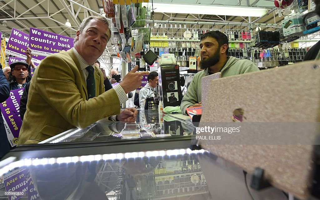 Leader of the United Kingdom Independence Party (UKIP) Nigel Farage (L) gestures as he campaigns to leave the European Union during a stop on his anti-EU bus tour, in Birmingham, central England, on May 31, 2016, ahead of Britain's forthcoming EU referendum. Politicians and world leaders have dominated the headlines in the campaign for Britain's Jun 23, 2016 EU referendum, but a passionate battle for the country's future is also being fought by activists on the streets. / AFP / PAUL