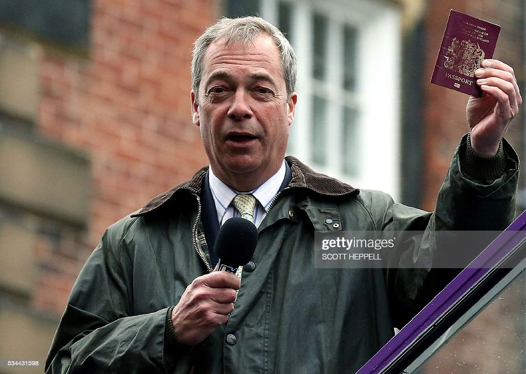 Leader of the United Kingdom Independence Party (UKIP), Nigel Farage holds aloft a British Passport as he canvasses for supporters whilst campaigning to leave the European Union, ahead of the June 23 referendum, in Newcastle upon Tyne, north-east England on May 26, 2016. A series of recent polls suggest a widening lead for supporters of Britain's continued European Union membership, handing 'Remain' campaigners a psychological boost, before the country votes in a crucial in-out referendum on June 23. / AFP / SCOTT