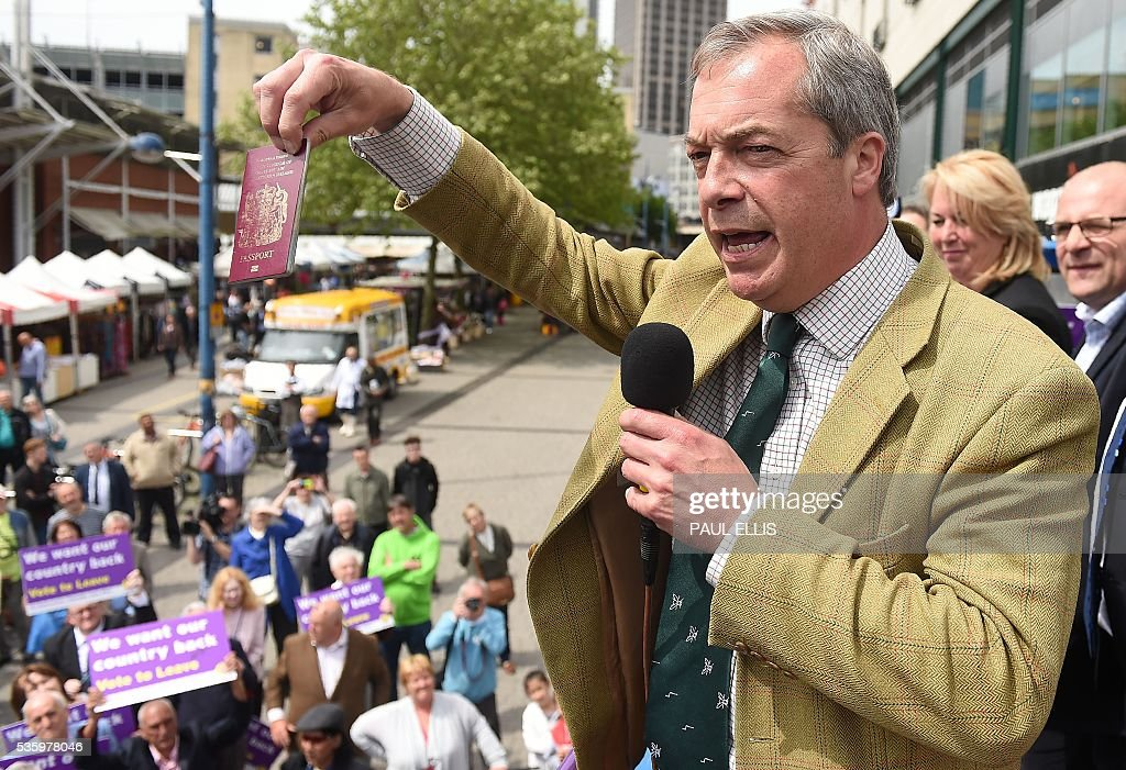 Leader of the United Kingdom Independence Party (UKIP) Nigel Farage holds aloft a UK Passport as he speaks during an anti-EU campaign event, in Birmingham, central England, on May 31, 2016, ahead of the forthcoming referendum. Politicians and world leaders have dominated the headlines in the campaign for Britain's Jun 23, 2016 EU referendum, but a passionate battle for the country's future is also being fought by activists on the streets. / AFP / PAUL