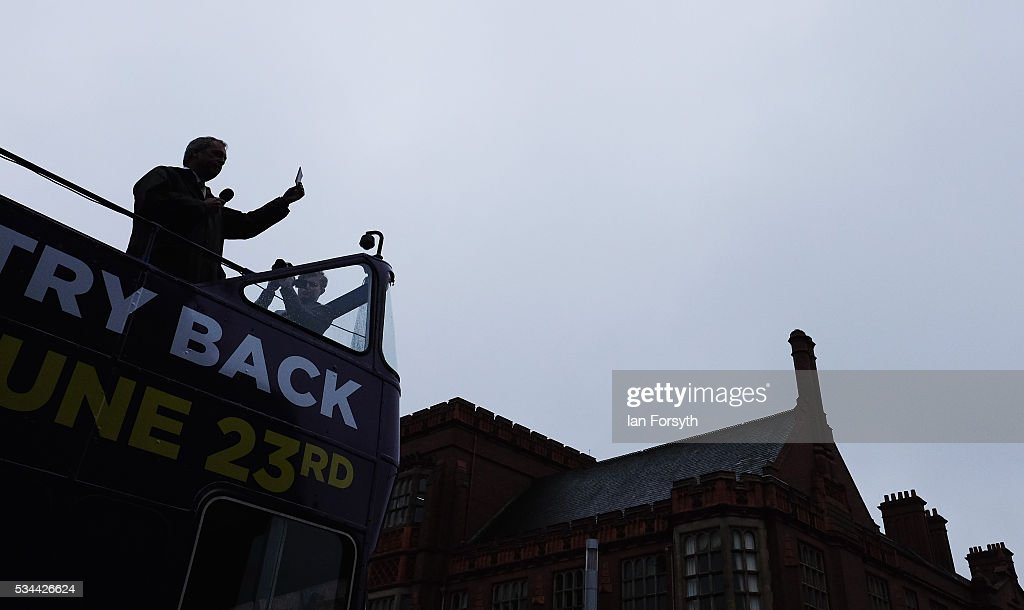 Leader of the United Kingdom Independence Party (UKIP), Nigel Farage holds his passport up as he speaks to waiting supporters after arriving in his battle bus as he campaigns for votes to leave the European Union on May 26, 2016 in Newcastle Upon Tyne, England. Mr Farage arrived at St Mary's Place in the city to encourage British people to vote to leave the EU in the June 23rd referendum.