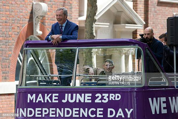 Leader of the United Kingdom Independence Party Nigel Farage laughs as he arrives to launch the party's opentop bus that will be touring the UK for...