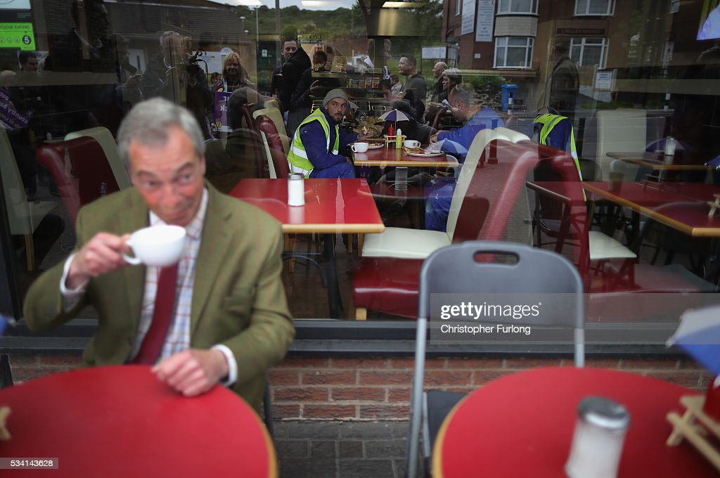 Leader of the United Kingdom Independence Party (UKIP), <a gi-track='captionPersonalityLinkClicked' href=/galleries/search?phrase=Nigel+Farage&family=editorial&specificpeople=697991 ng-click='$event.stopPropagation()'>Nigel Farage</a> lis watched by builders as he drinks coffee outside a cafe during campaigning for votes to leave the European Union on May 25, 2016 near Sheffield, England. <a gi-track='captionPersonalityLinkClicked' href=/galleries/search?phrase=Nigel+Farage&family=editorial&specificpeople=697991 ng-click='$event.stopPropagation()'>Nigel Farage</a> took his battle bus to Chapeltown, near Sheffield, encouraging British people to vote to leave the EU in the June 23rd referendum.